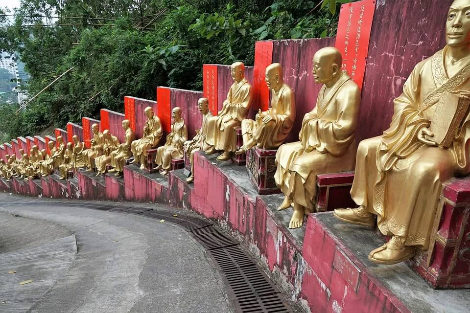 A line-up of life-sized buddhas at the Ten Thousand Buddhas Monastery in Hong Kong