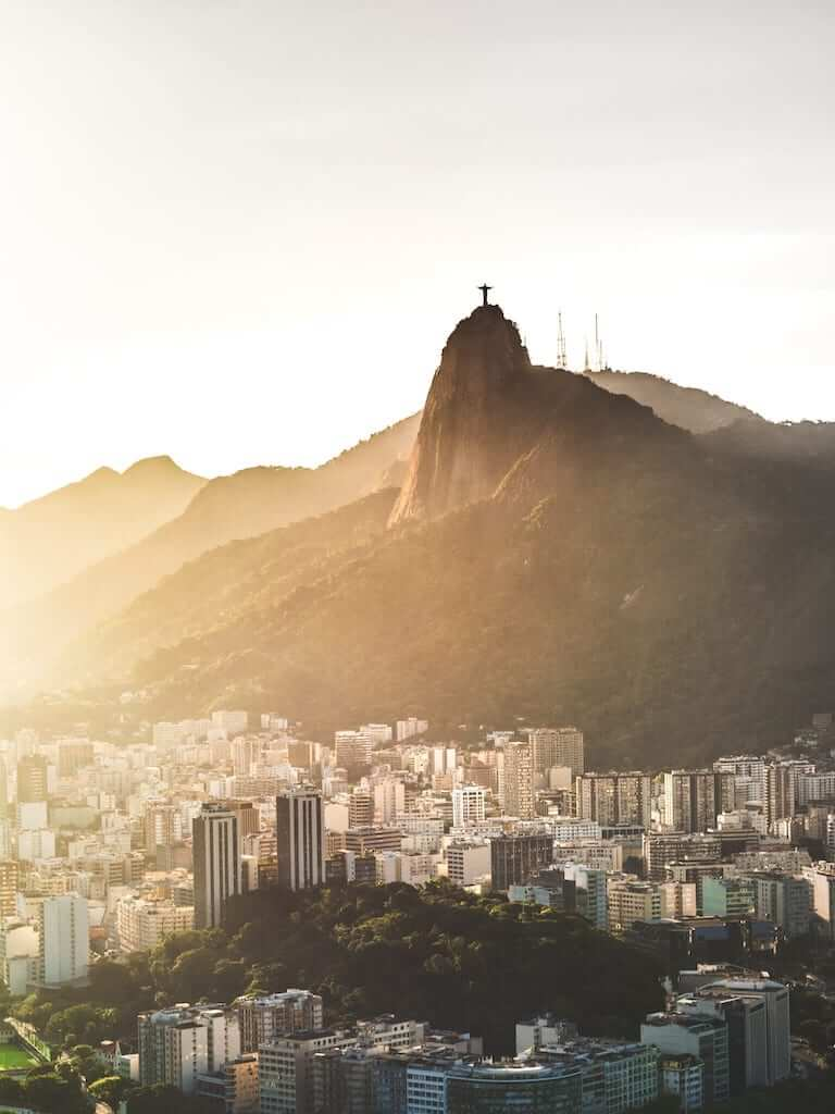 Buildings in rio with Christ the Redeemer in the background