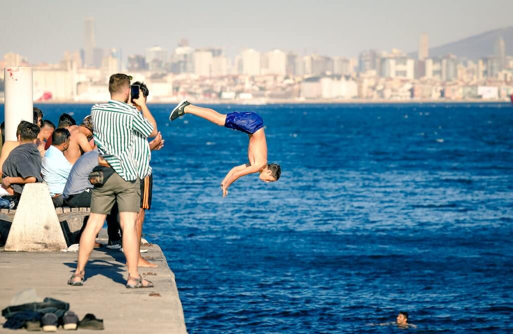 Boy jumping into the waters of the Bosphorus Strait