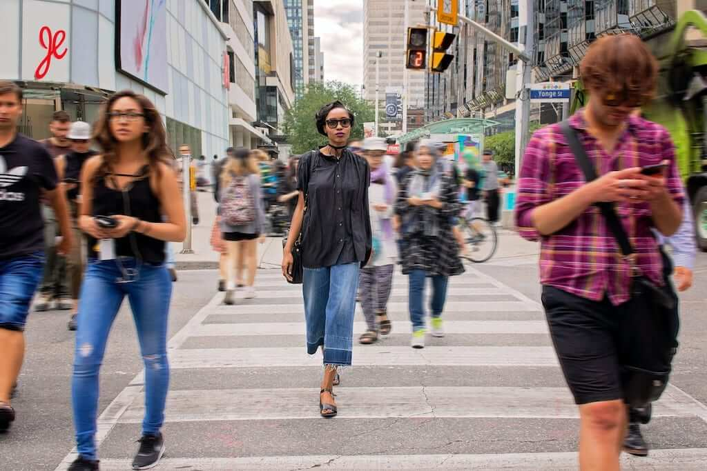 fashionable lady cross road