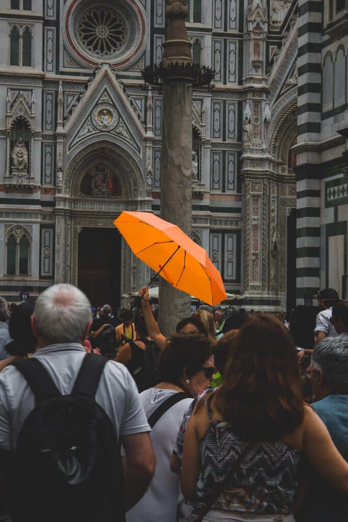 tour guide with umbrella in florence