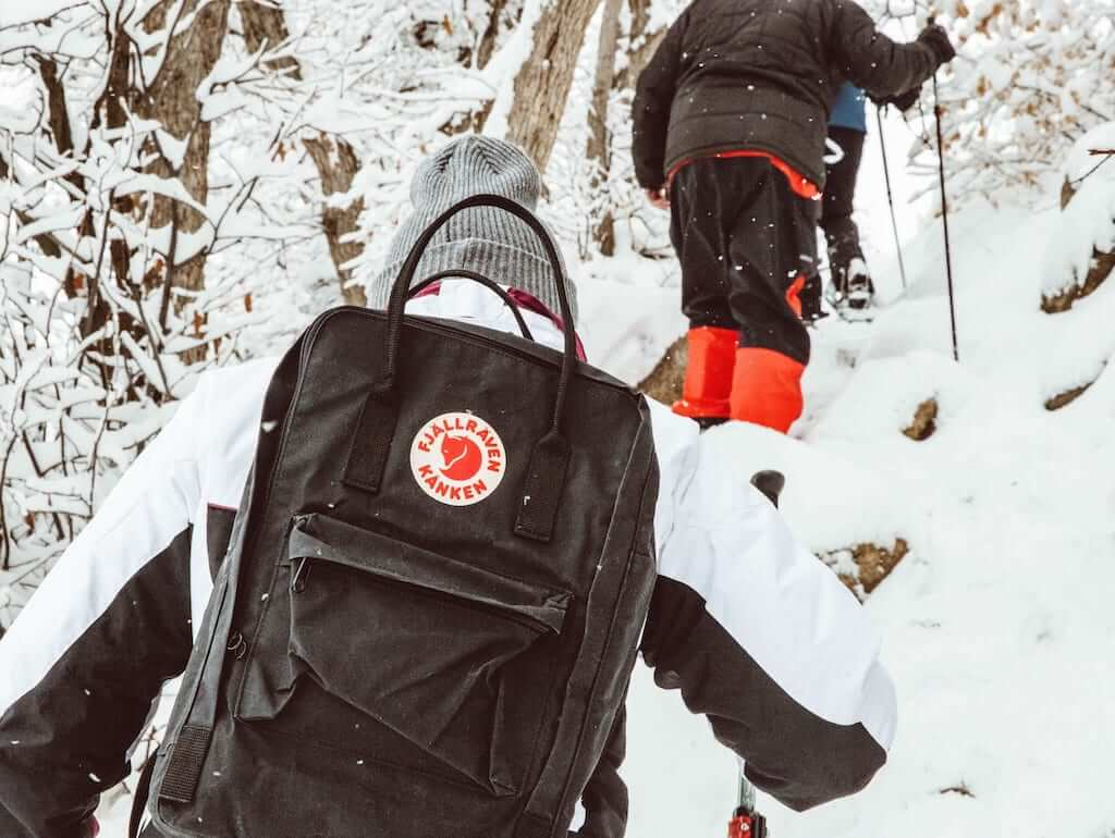 hiking in winter with a black kanken backpack