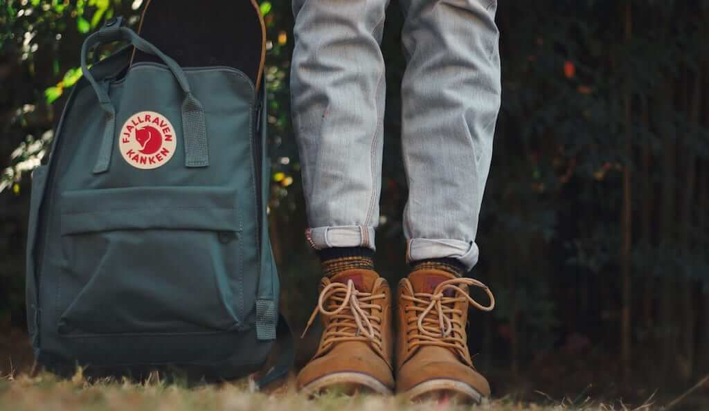 green blue kanken with girl's boots