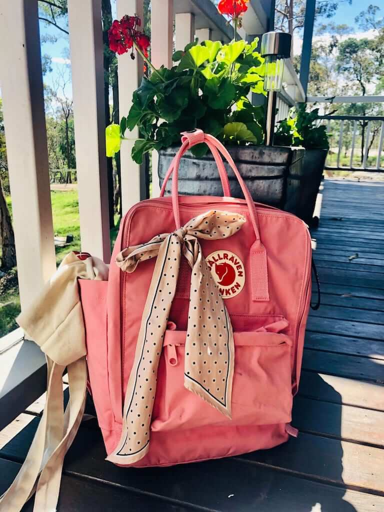 pink kanken backpack with a ribbon