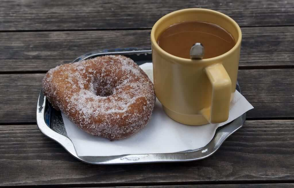 Munkki doughnut with a side of coffee