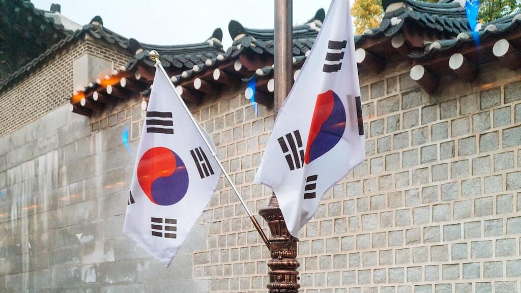 korean flags in front of palace