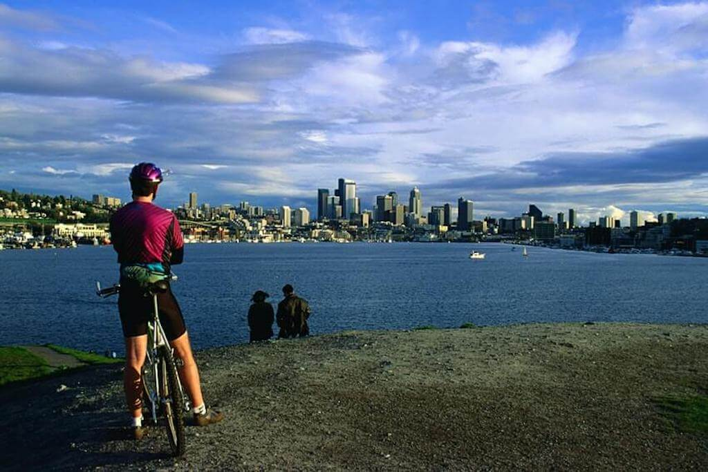 Man cycling along the Seattle waterfront