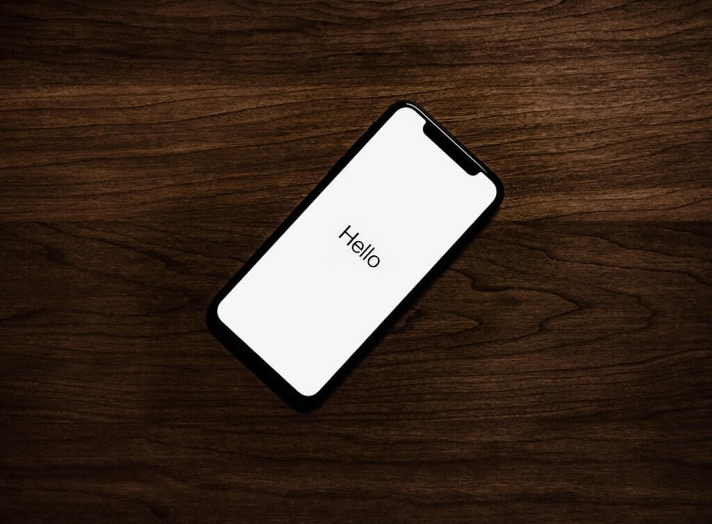 The words hello written on a phone screen