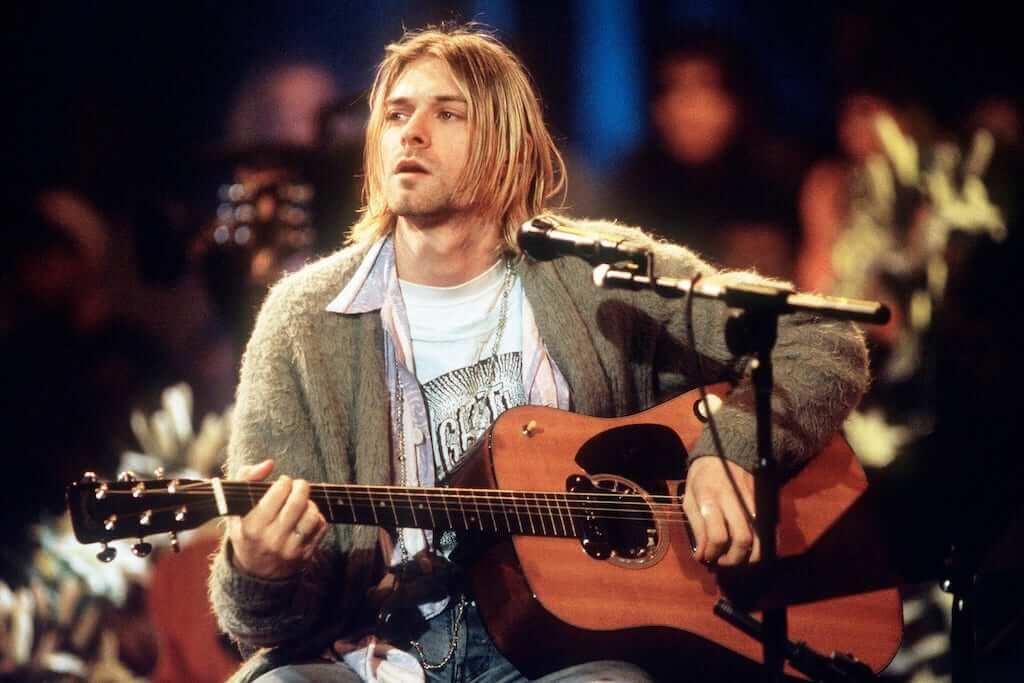 Kurt cobain playing a guitar