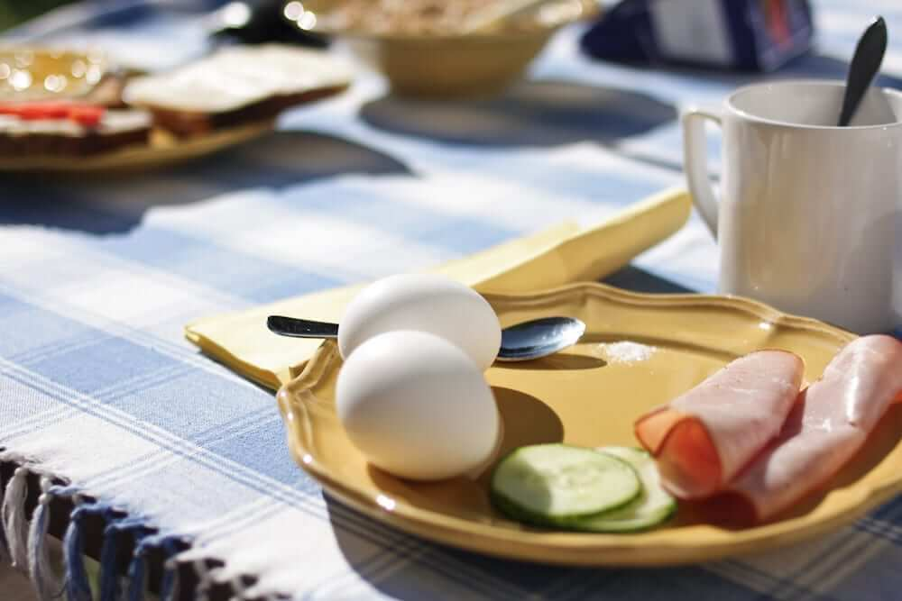 Typical finnish breakfast plate with eggs, cucumber and ham