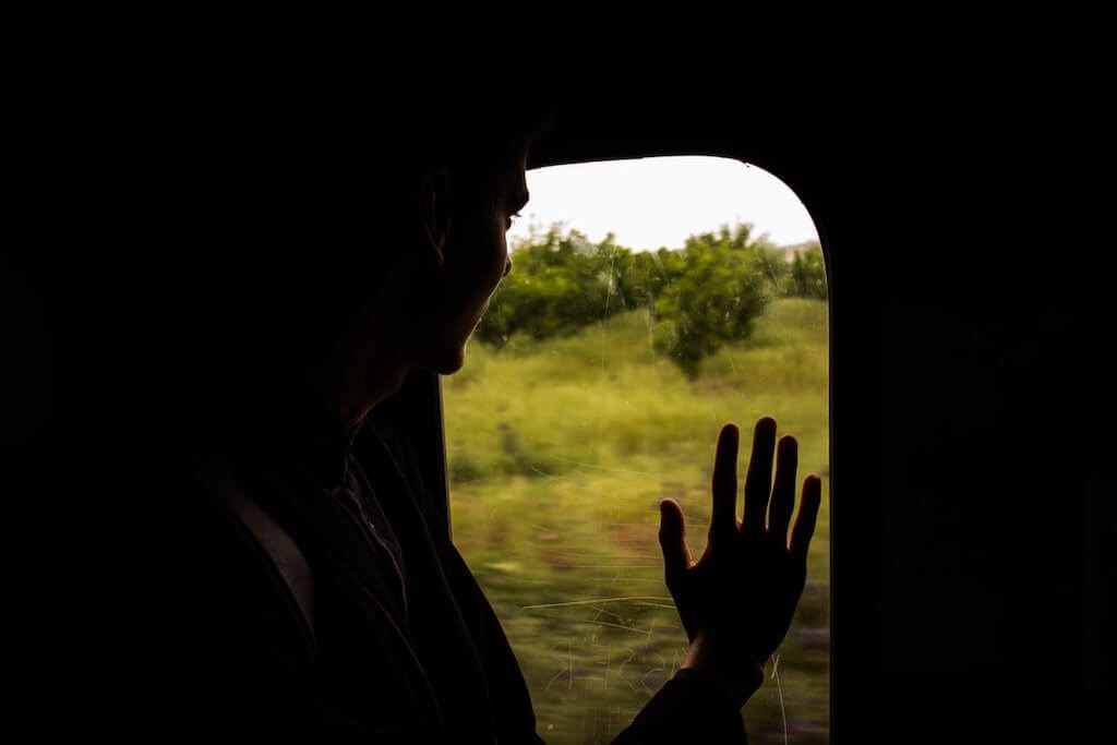 Waving goodbye out the train window