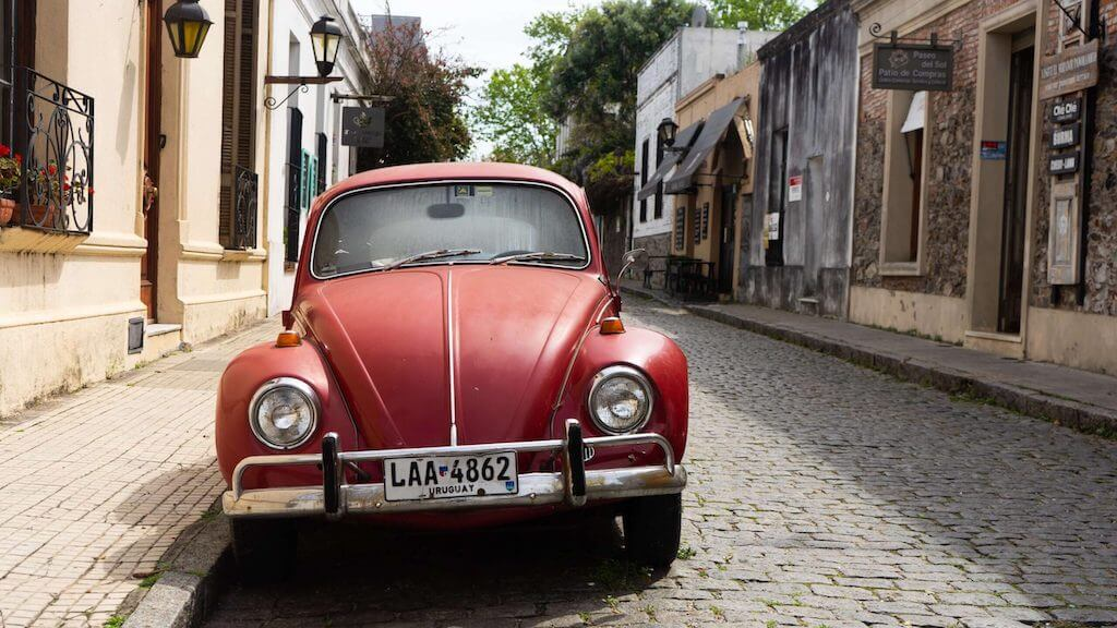 Red car in the streets of Colonia del Sacramento