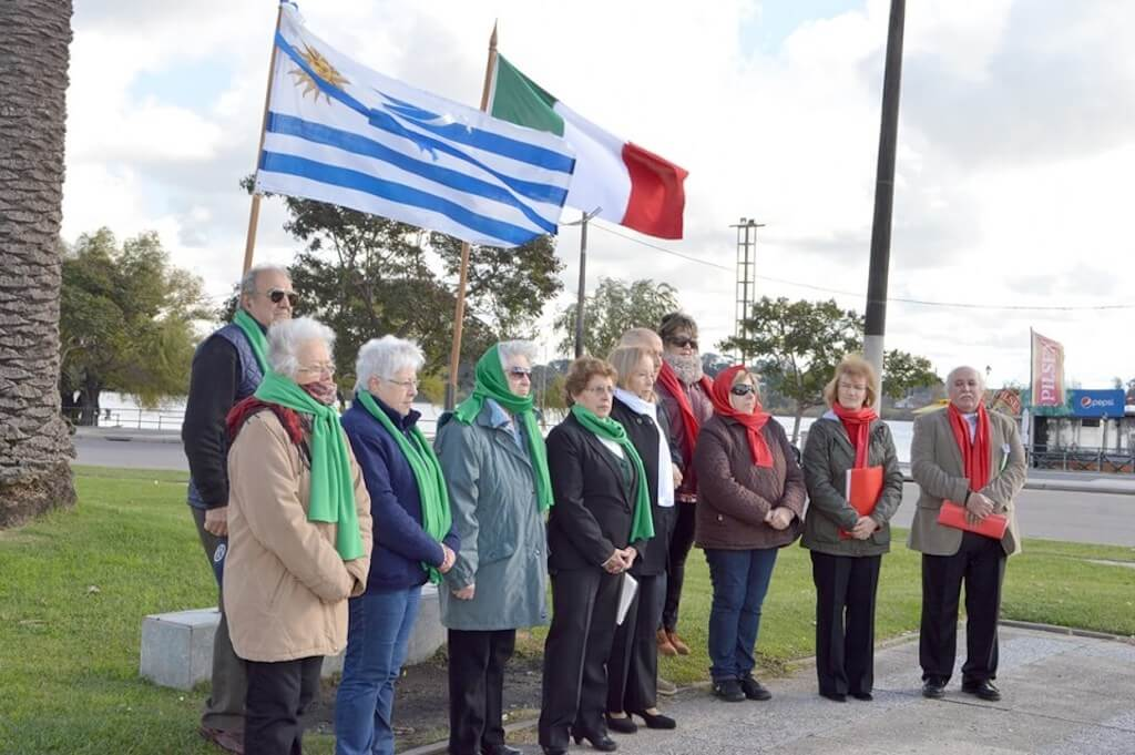 Italian immigrants in Uruguay standing in front of the flags