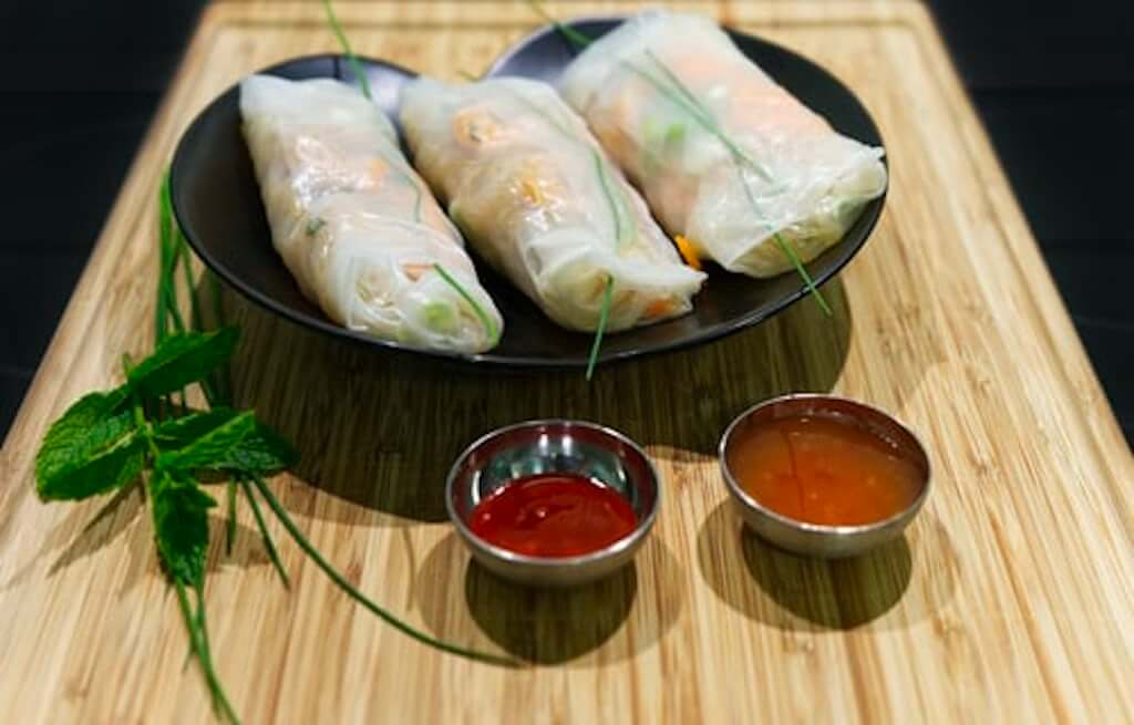 Vietnamese spring rolls with chili dips