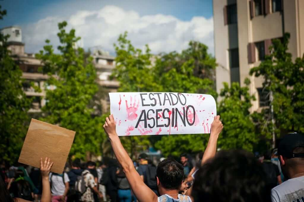 Man holding sign during protest in Chile
