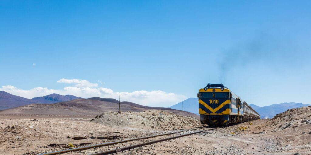 Train moving through Bolivia desert