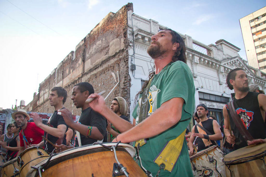 Group of people playing candombe and beating on drums