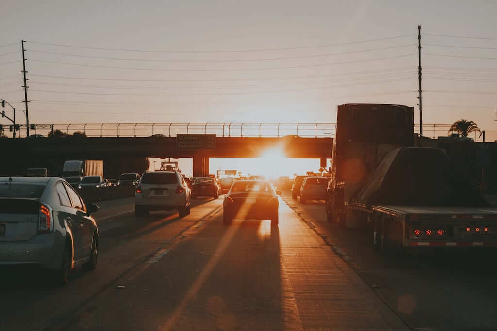 Cars on a highway during sunset