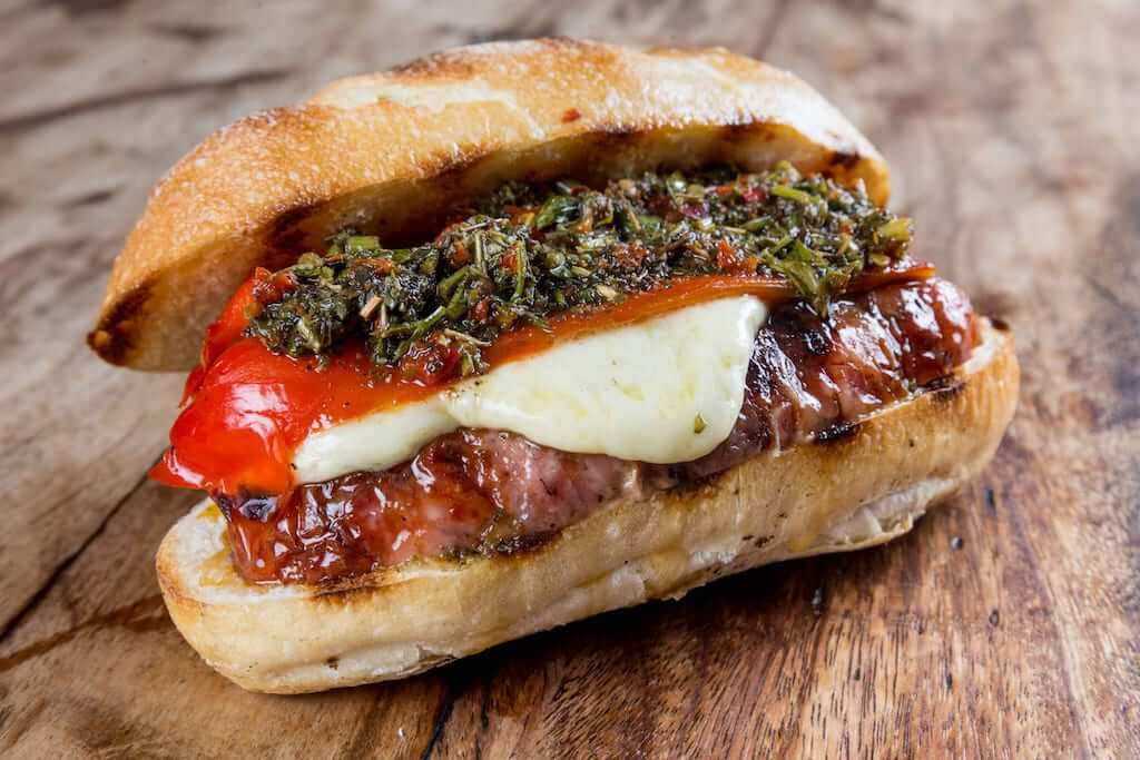 Choripan sandwich with hot dog and chimichurri