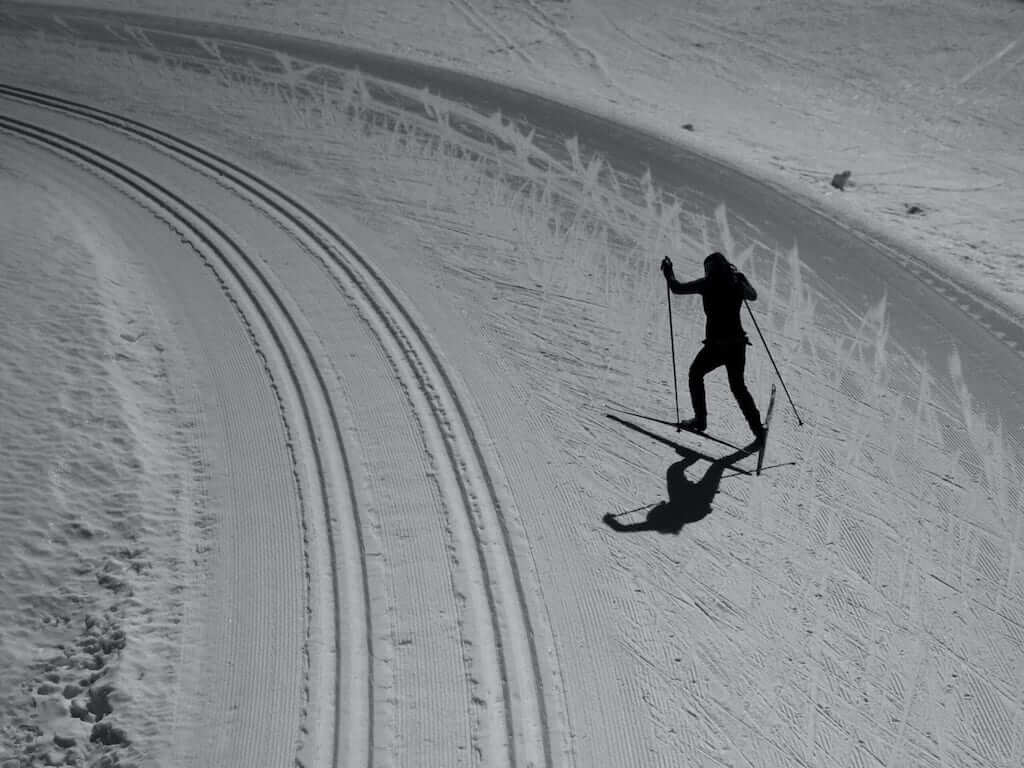 Shadow of a woman skiing