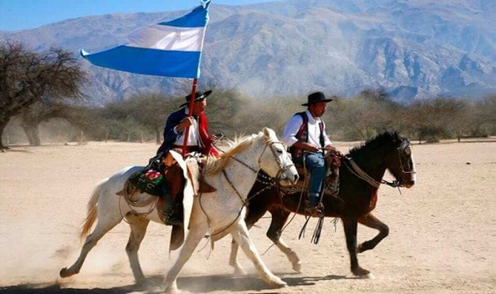 Two men on horses showing the gaucho culture