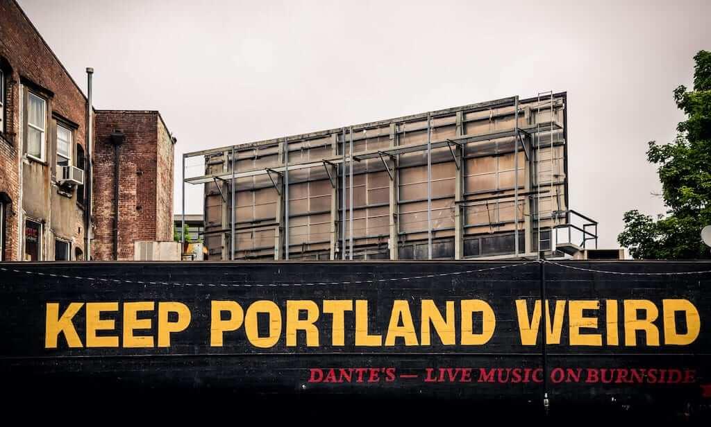 a sign saying keep portland weird