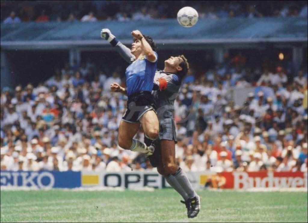 Maradona head butting a soccer ball
