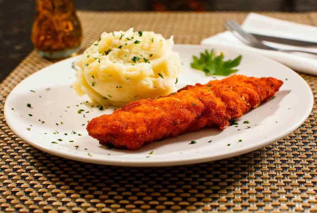 Milanesa, steak with mashed potatoes