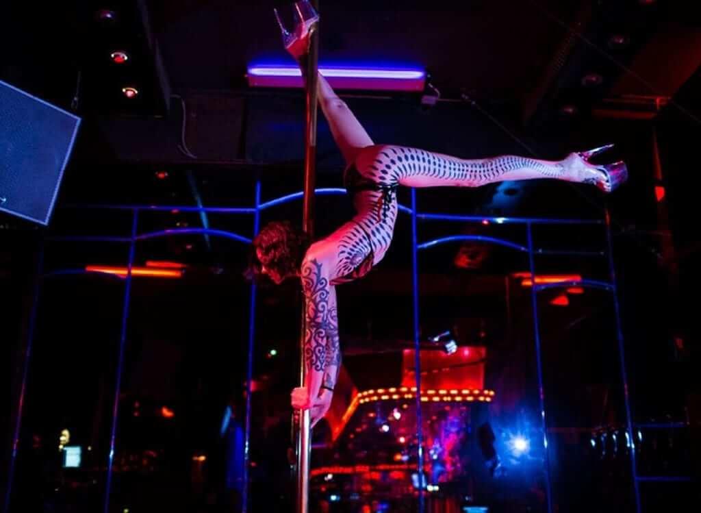 Woman dancing in a strip club