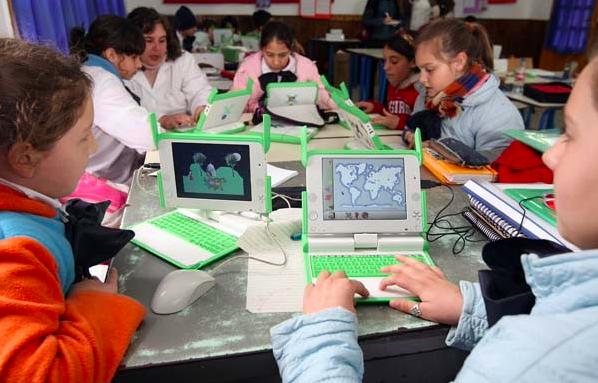 children using laptops in uruguay