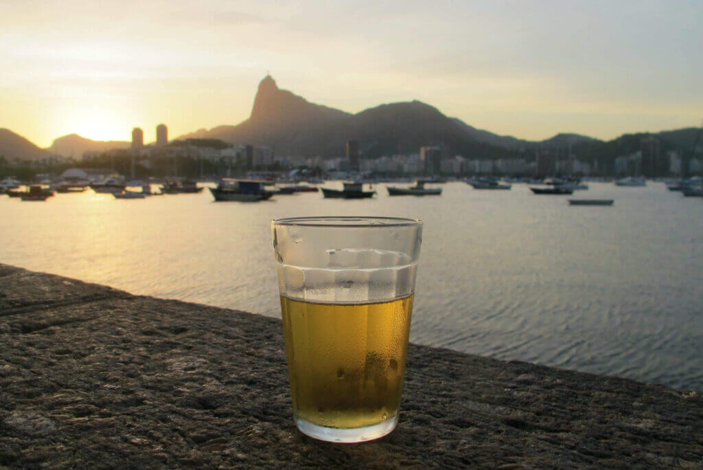 beer at urca in rio de janeiro with christ the redeemer on the background