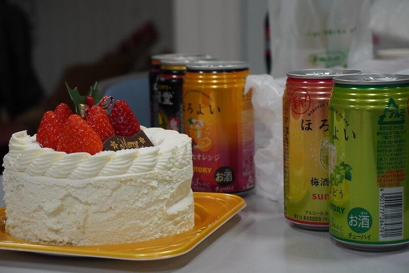 Japanese chuhai canned drinks beside a birthday cake