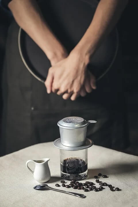 filtering coffee with a vietnamese phin