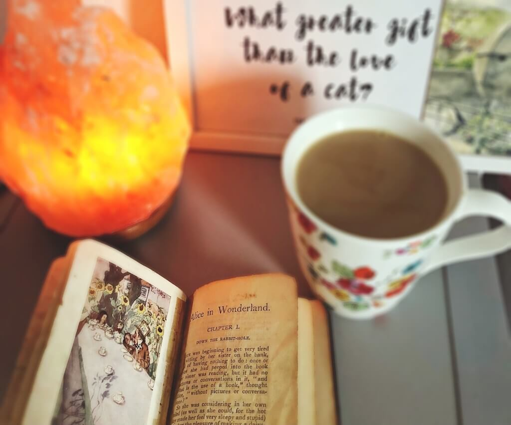 Alice and wonderland book with tea