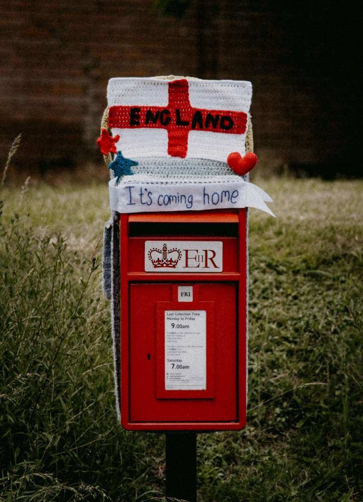 The english flag on top of a letterbox