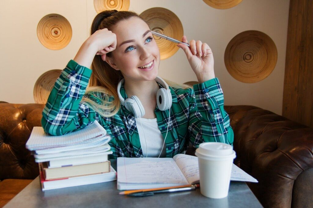 Girl learning chinese with books