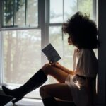 reading book by the window