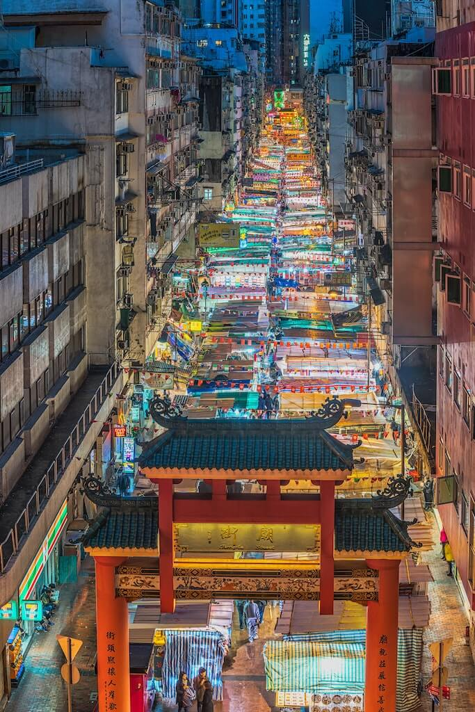 Temple Street Night Market jam-packed with street stalls at night