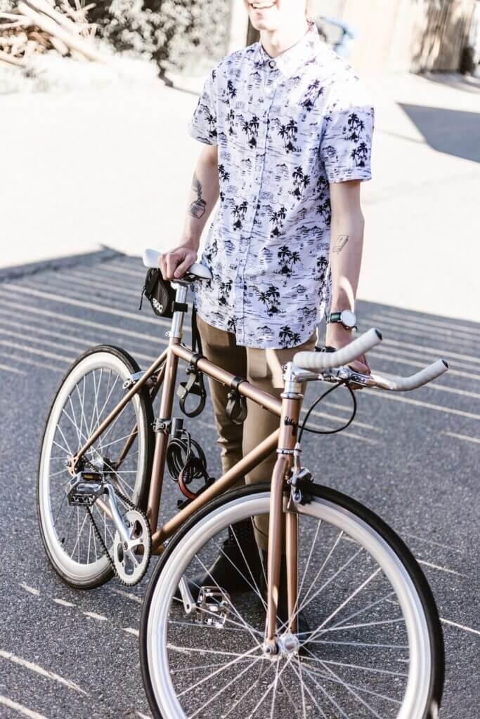 Man with Aloha shirt and bicycle