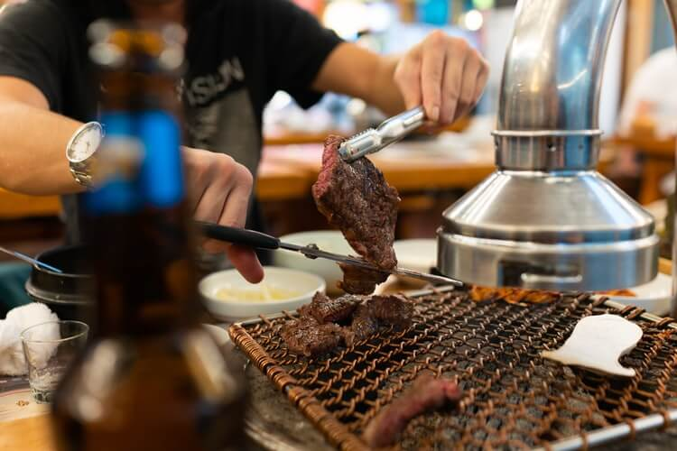 grilling meat on a barbecue table