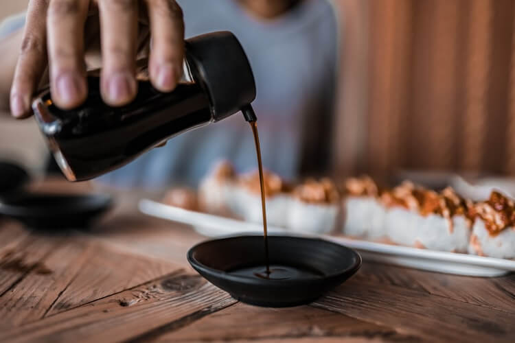 pour soy sauce to eat with sushi