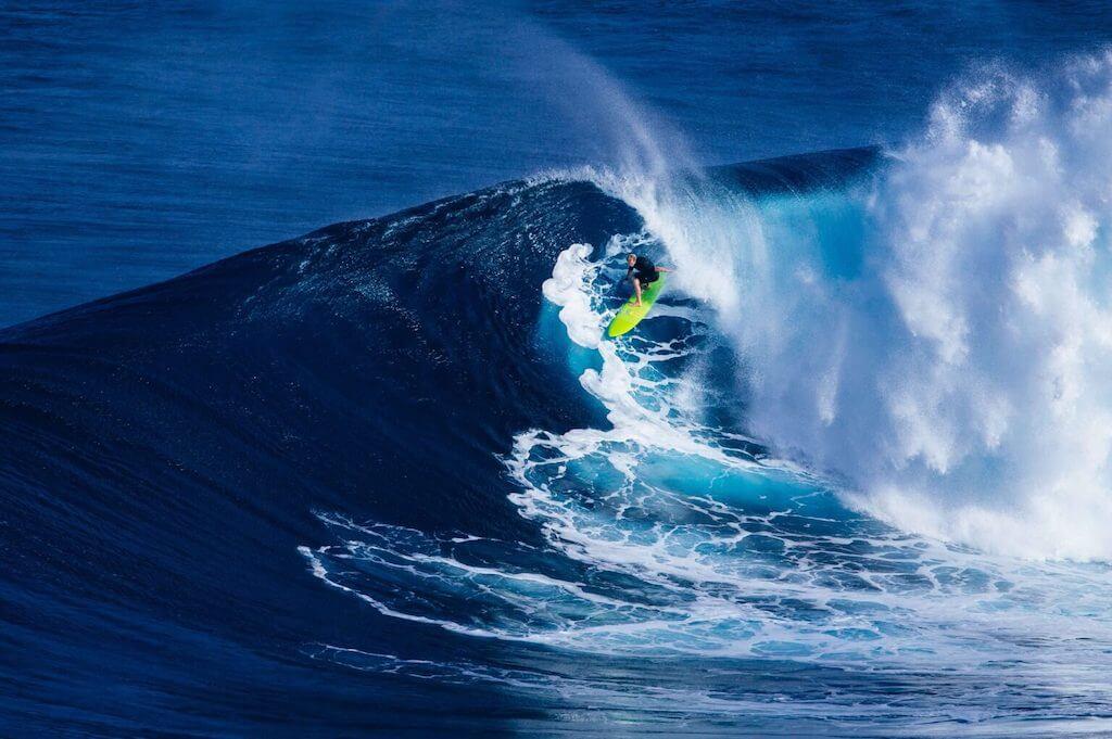 Surfer on a huge wave