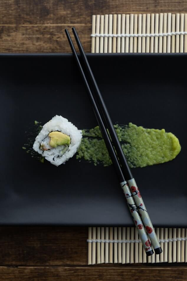 a single sushi with lots of wasabi
