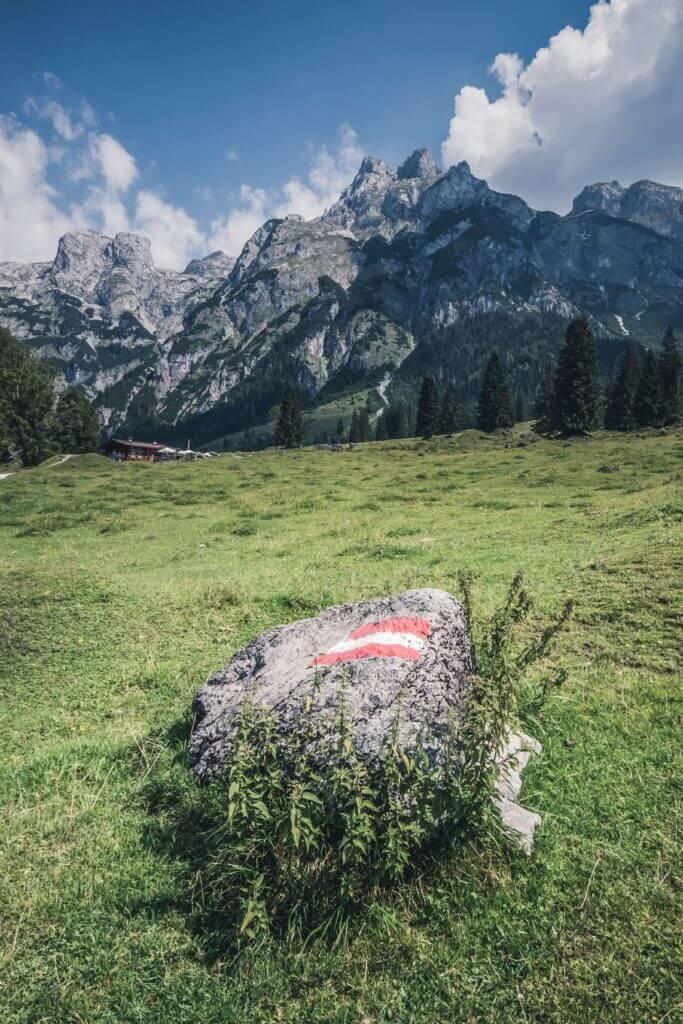 The Austrian flag on a hiking trail