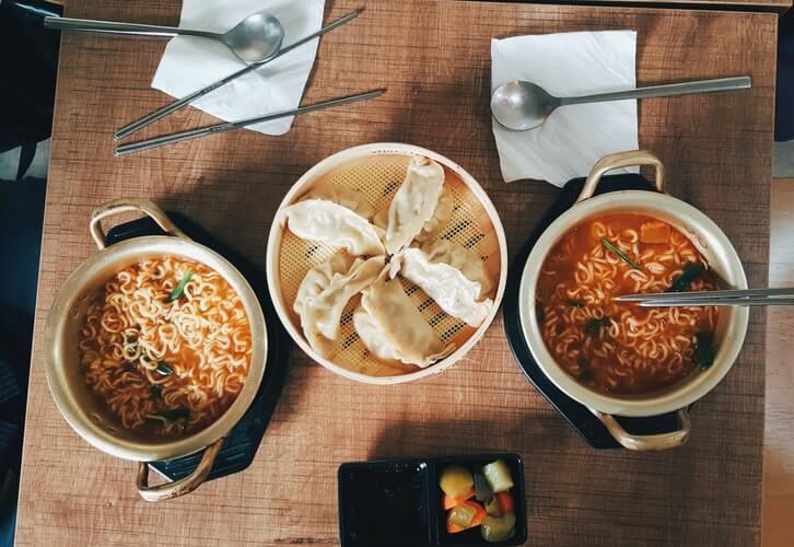 two bowls of korean instant ramen noodles