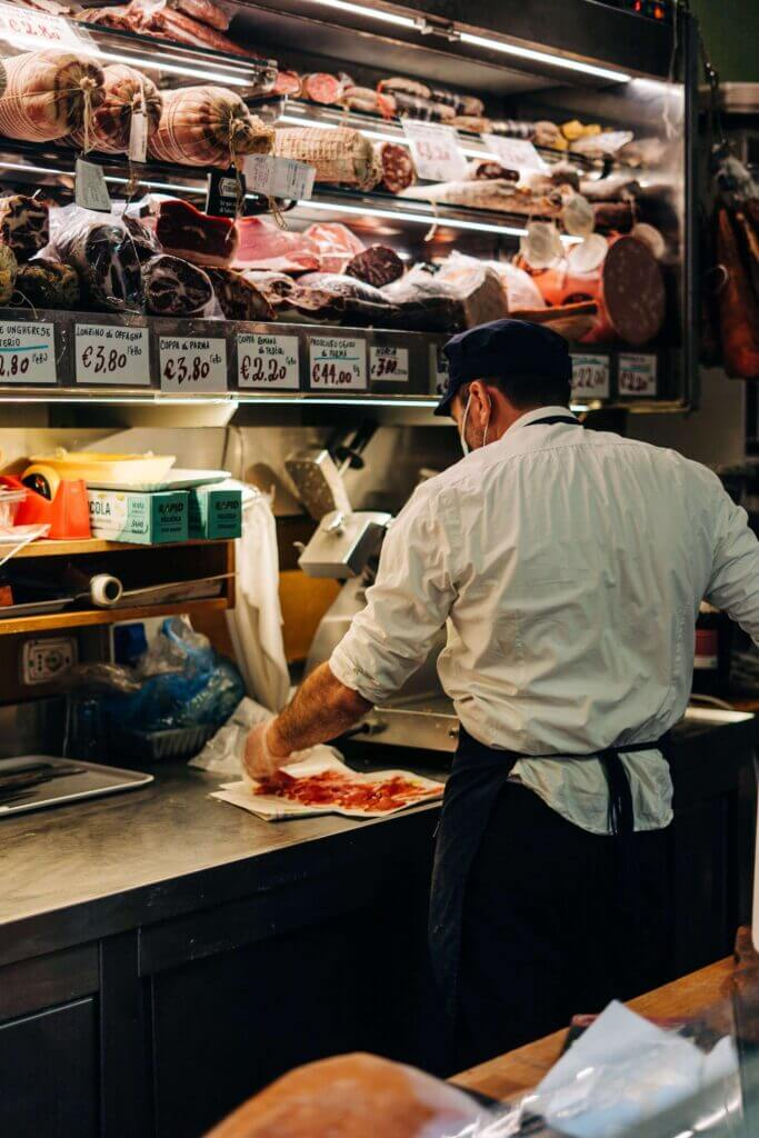 Man selling meat in Italy