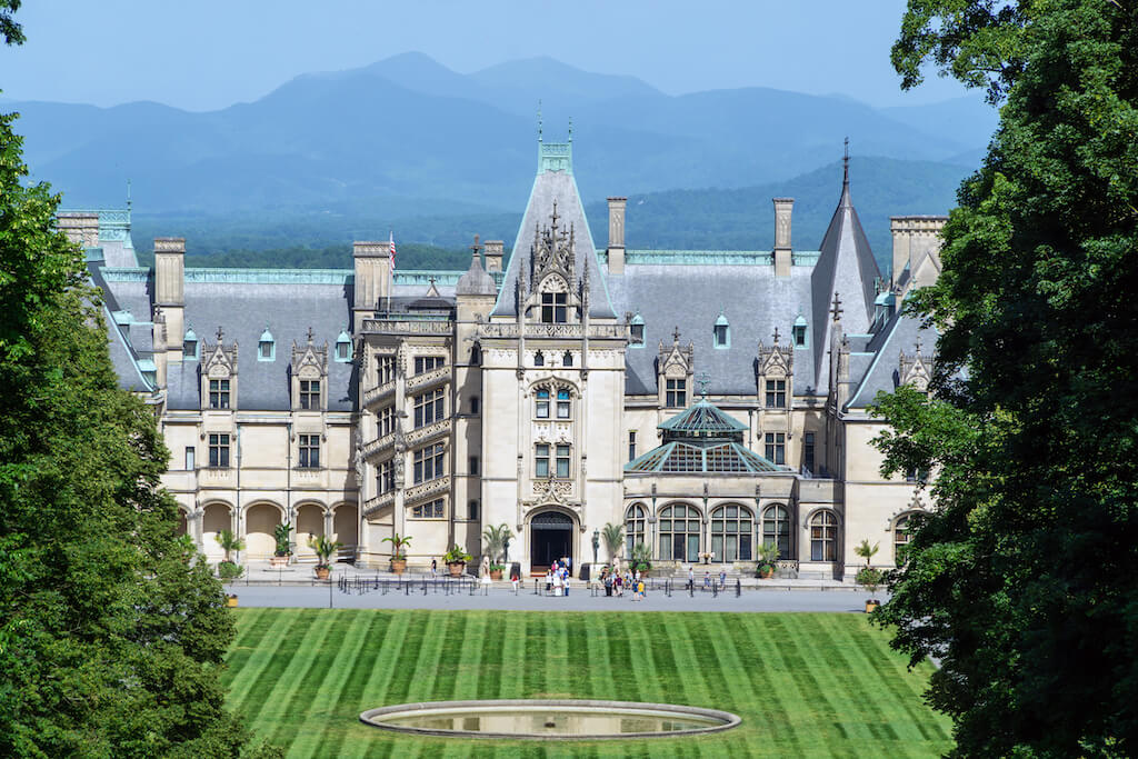 An outside view of Biltmore Estate with the Blue Ridge Mountains in the background