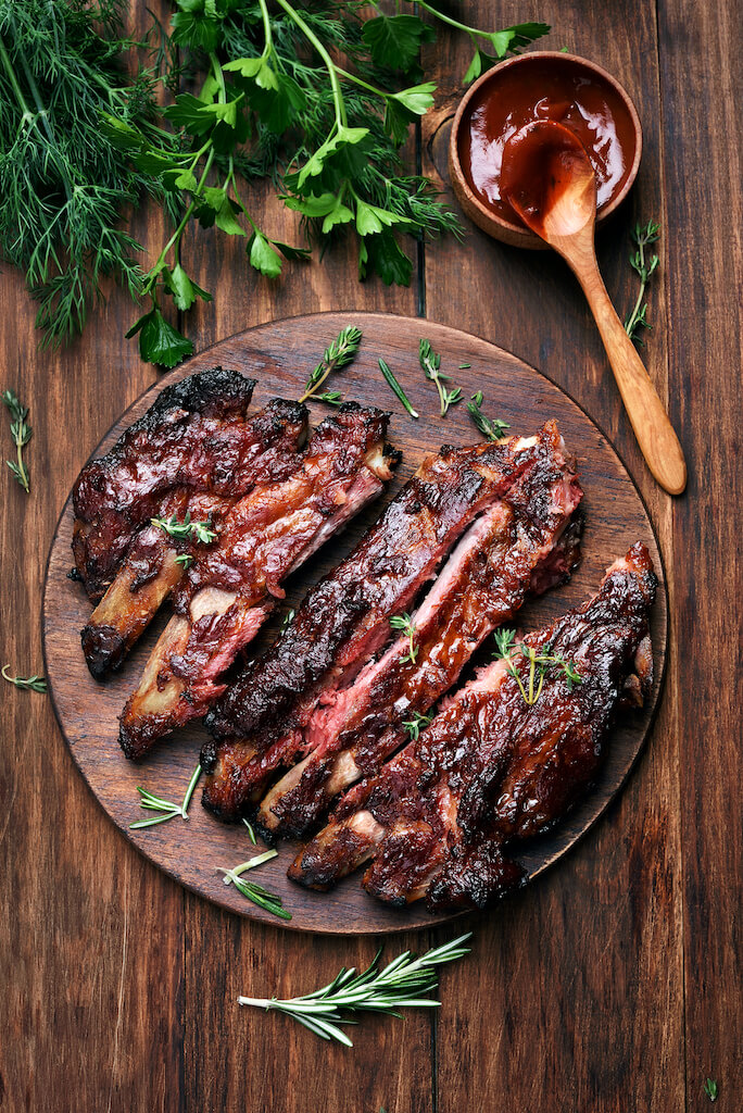 Barbecue ribs on a wooden cutting board