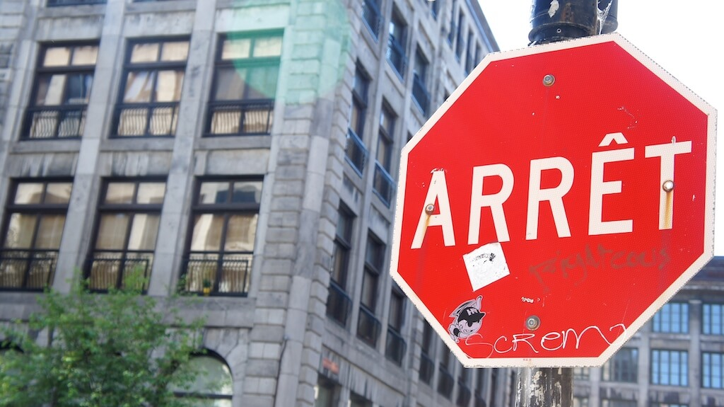"""Sign saying """"arret"""" in French"""